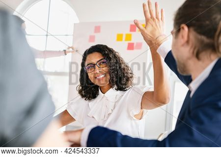 Business people giving a high five