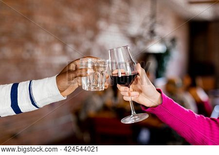 Friends clinking their glasses at a dinner party