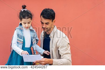 Horizontal Image Of A Handsome Father Meeting His Daughter After School. Father Enjoying The Time To