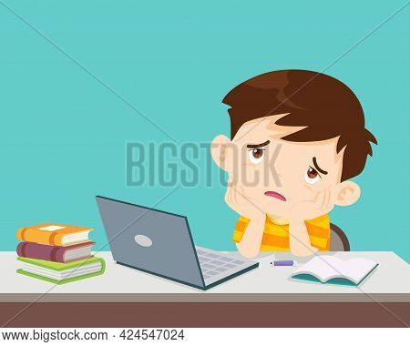 Child Boy Bored Of Studying In Front Of The Laptop. Concept Of Tired Kid From Home E-learning Or Onl