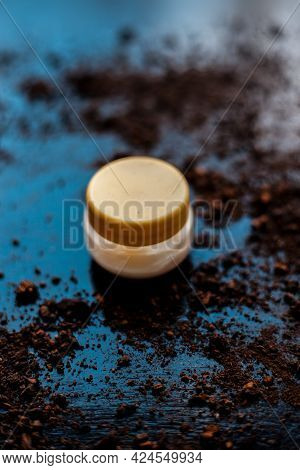 Shot Of Sour Cream On The Wooden Surface Along With Some Cocoa Powder Sprinkled Around It.