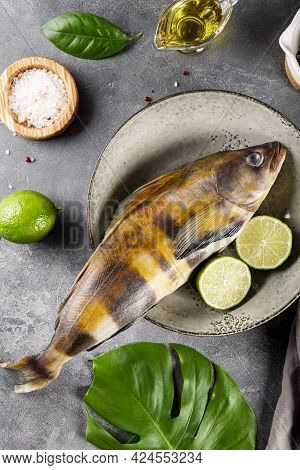 Raw Fish Sea Bass Or Lingcod And Seasonings For Cooking It On A Gray Background Top View Vertical Ph