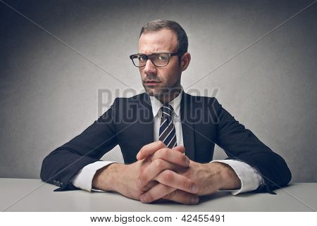serious businessman sitting at his desk