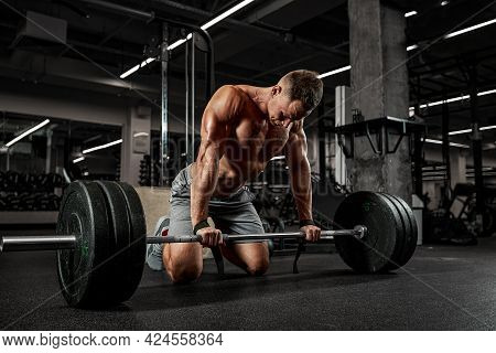 The Concept Of Motivation, Overcoming Yourself And Your Fears, An Athlete In The Gym Doing Exercises