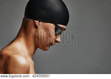 Face Of A Man Swimmer Close-up, Gray Background, Copy Space, Young Guy Swimmer In A Mask And Swimmin
