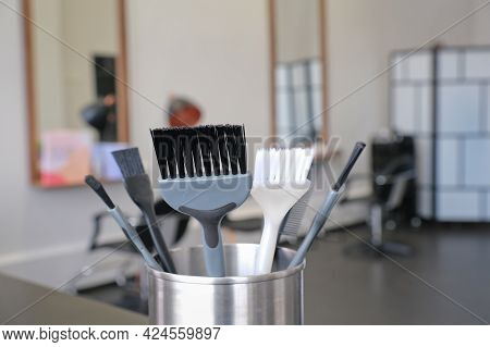 Hair Dye Brushes On The Blurred Background Of A Hairdressing Salon Interior. Hair Coloring Tools Set