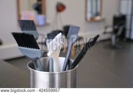 Professional Brushes For Hair Colorist And Hairstylist On The Blurred Background Of A Hairdressing S