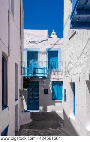 Portrait Vertical View Of Plaka Town Street On Milos Island, Greece With No People. Traditional Gree