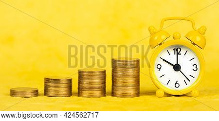 Growing Money Coin Stacks With Clock, Passive Income, Financial Success Concept. Web Banner.