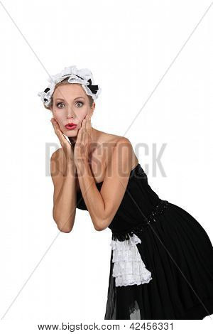 Woman in a saucy  French maid's outfit