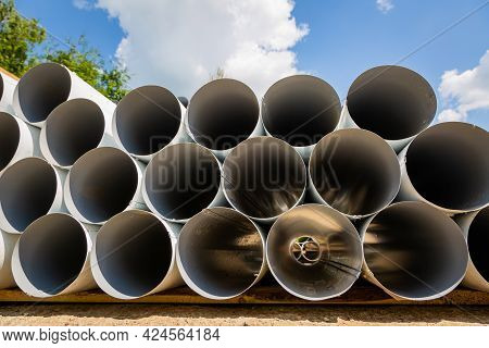 Downpipe Warehouse. Steel Pipes, Parts For The Construction Of A Roof Drainage System In A Warehouse