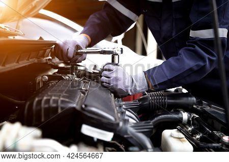 Auto Mechanic Working On Car Engine In Mechanics Garage.repair Service,car Service, Repair, Maintena