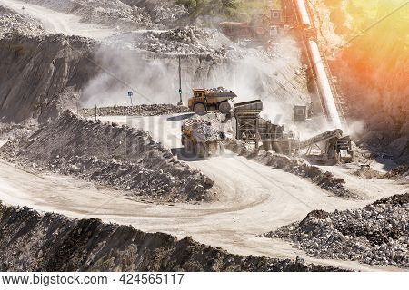 Quarry Mining With Beautiful Sunlight. The Mining Industry Concept.