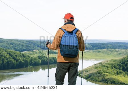 Man Hiker Observing The The Green Valley With Lake And Thinking. Travel Lifestyle Wanderlust Adventu