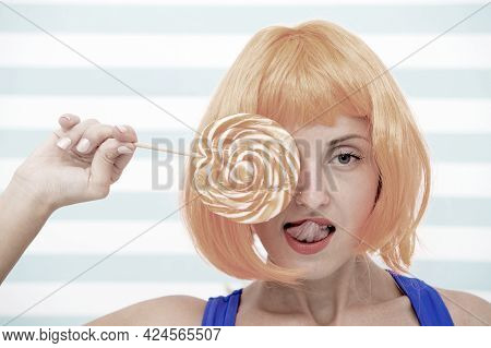 Crazy Girl In Candy Shop. Pretty Girl With Lollipop In Sweet Shop. Crazy About Candies. Sexy Gwoman