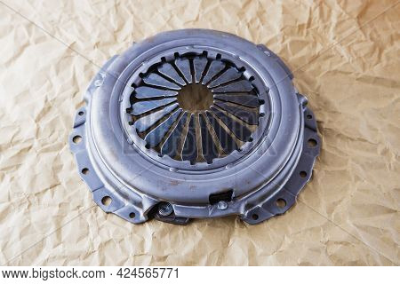 Passenger Car Clutch Basket. Photo Of A New Clutch On A Background Of Craft Paper.