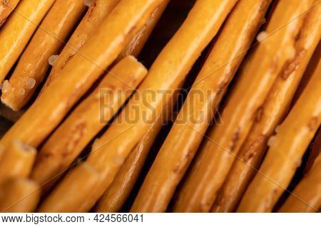 Breadsticks With Salt Surface Texture. Close-up Selective Focus