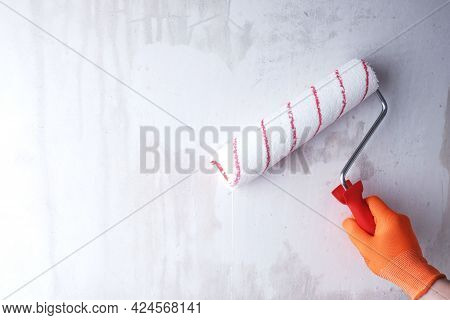 Priming The Wall With Roller, Hand In Glove Close-up, Painting Work