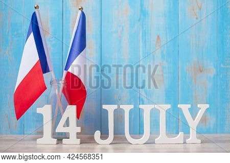 Wooden Calendar Of July 14th With Miniature France Flags. French National Day, Bastille Day And Happ