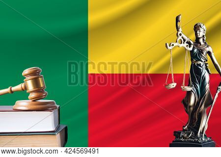 Law And Justice In Benin. Statue Of Themis And The Gavel Of The Judge Against The Background Of The