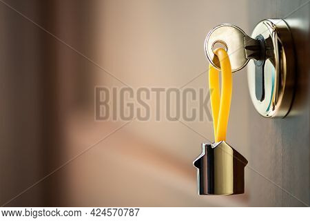 House Key In The Door. Close House Key On A House Shaped Silver Keyring In The Lock Of A Entrance Br