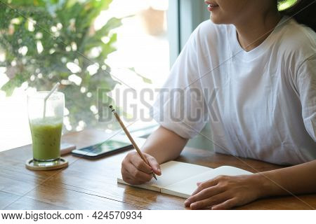 Close Up Asian Women Hold Pencil For Write Something On Her Notebook, Education Concept, Writer Conc