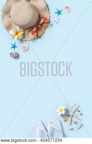 Summer Beach Background Design Concept With Shells, Hat, Slipper On Blue Background.