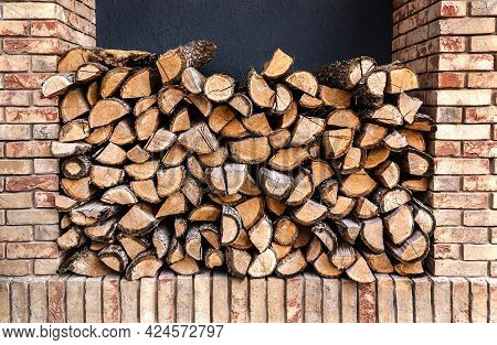 Chopped Wooden Logs In Stack. Wooden Logs Background For Your Design.