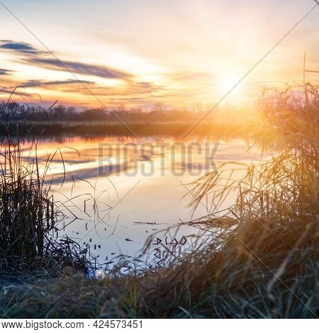 Beautiful Sunset Over A Small River. Evening Landscape
