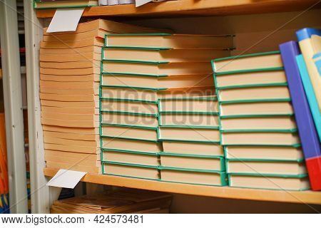 Stacks Of Books On A Shelf In The Library. Selective Focus