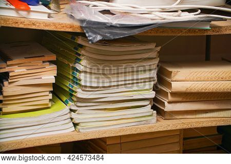 Stacks Of Old Books On A Shelf In The Library. Selective Focus