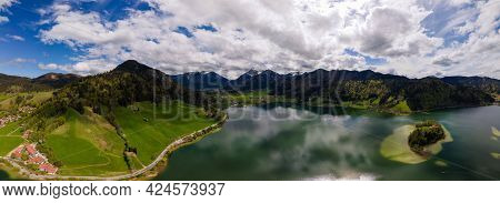 A Wide Aerial Panorama Of Laa Wide Aerial Panorama Of Lake Schliersee And Surrounding Mountains In B
