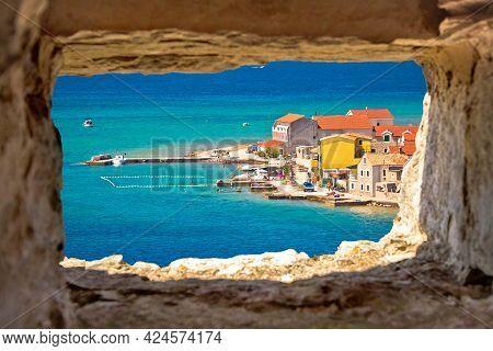 Island Of Krapanj Colorful Waterfront View Through Stone Window, Dalmatia Archipelago Of Croatia