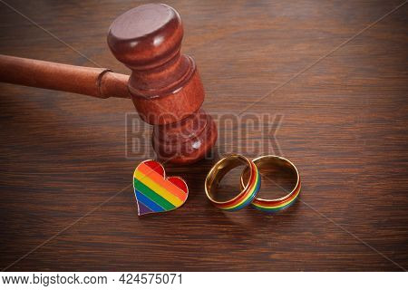 Two Gold Wedding Rings With Lgbt Rainbow Colours. Homosexual Marriage. Lgbt Rights And Law.