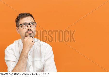 Handsome Caucasian Man In Eyeglasses Feeling Thoughtful, Wondering Or Imagining Ideas, Daydreaming A