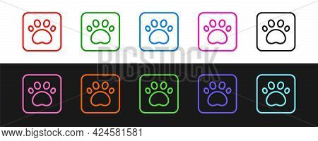 Set Line Paw Print Icon Isolated On Black And White Background. Dog Or Cat Paw Print. Animal Track.