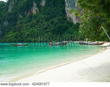 Long-tail Boats In Phi Phi Island, Krabi, Thailand