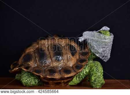 Figurine Of Decorative Turtle And Packing Plastic On The Head