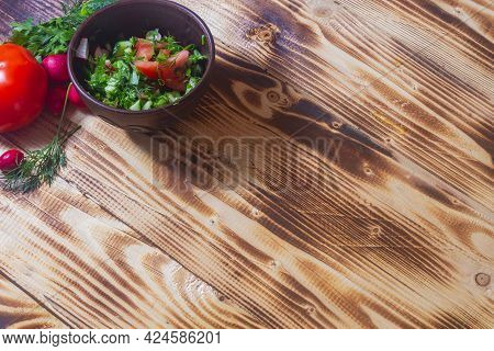Vegetable Salad In A Clay Bowl On A Wooden Table, Sliced Vegetables Tomatoes, Cucumber, Dill, Onion,
