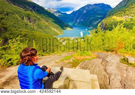 Tourism Vacation And Travel. Female Tourist Enjoying Beautiful View Over Magical Geirangerfjorden Fr