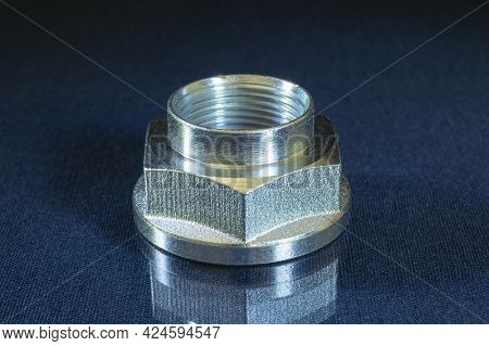 Metal Nut With Thread On The Table With Reflection. Details For Fasteners On A Black Background