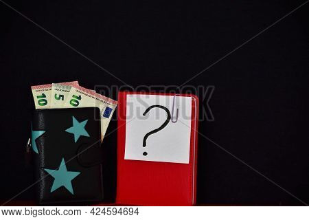 Leather Wallet With Euro Bills And Note With Question Mark On Black Background