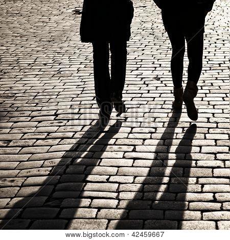 Shadows Of People Walking In A Street