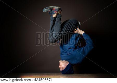 Hip Hop Dancer Perform Headstand Upside Down In Dark Studio B