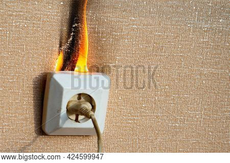 Defective Wiring Causes A Fire. An Old, Worn Out Socket Requiring Replacement. The Power Outlet Star