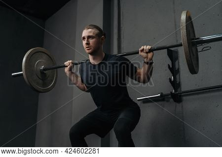 Strong Athlete Having Workout And Bodybuilding With Barbells Weight Lift Squat In Fitness Club. Musc