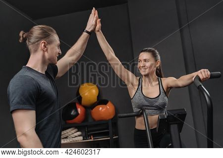 Smiling Athlete Woman Giving High Five Her Trainer, Taking Individual Workout Class With Personal Co