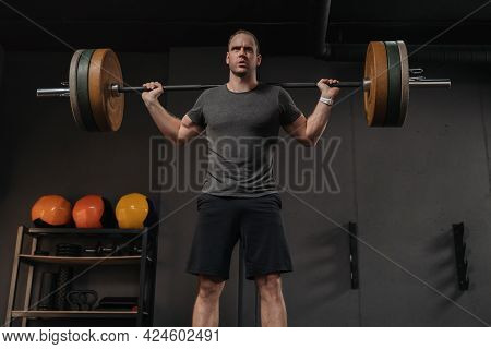 Muscular Brutal Sportsman Training With Heavy Weight Barbell In Gym. Powerlifting, Weightlifting, Fu