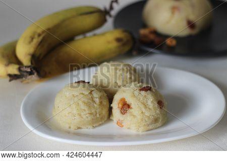 Semolina Banana Pudding. A Fluffy Indian Pudding Made Of Semolina, Ghee, Sugar, Bananas And Garnishe