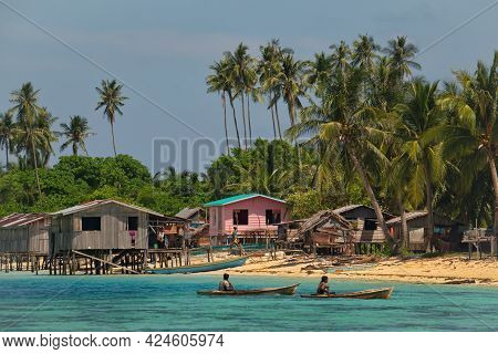 Semporna. Malaysia. November 29, 2018. Fishermen Of The Village Of Sea Gypsies Swim On Homemade Boat